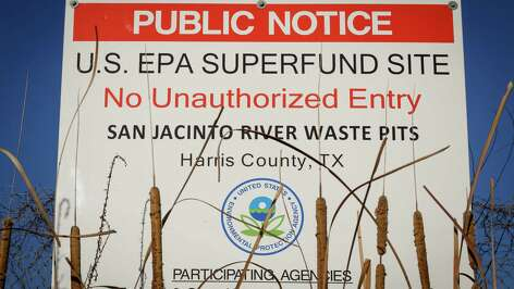 A sign warns the public about the EPA Superfund Site not to eat contaminated seafood caught from the water along Interstate 10 near the San Jacinto River east of Houston in Channelview.