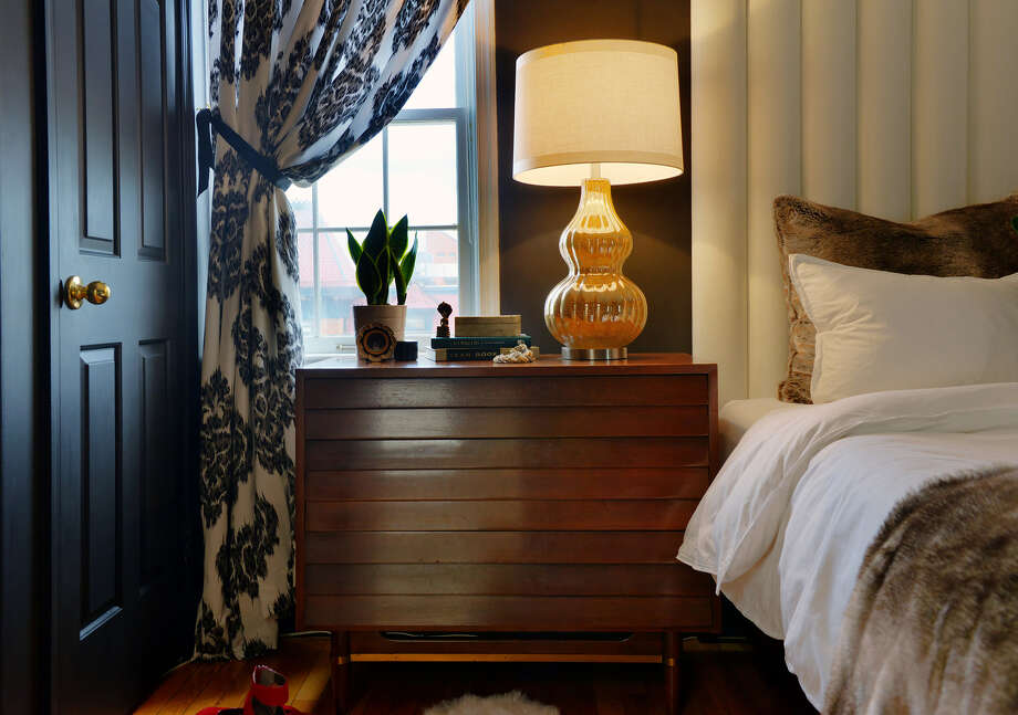 Huerta's new glam bedroom features black walls, a white faux leather DIY headboard and faux fur pillows and throw from Restoration Hardware. Photo: Bill O'Leary /Washington Post / THE WASHINGTON POST