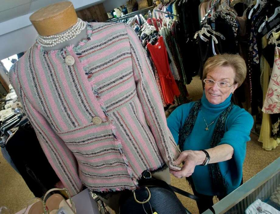Patti Murphy, a partner in the Bring N Buy consignment store, with a Chanel jacket from Paris.  Photo: Scott Mullin / The News-Times