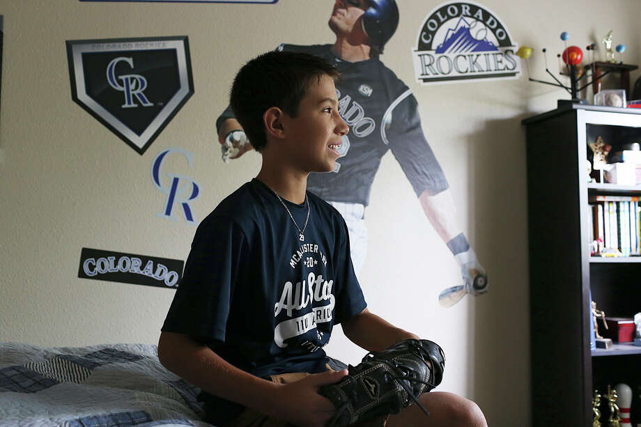 McAllister Little League player Jacob Coolbaugh, 11, poses in his room, Thursday, August 6, 2015. Coolbaugh is the son of former professional baseball player turned coach Mike Coolbaugh. He was tragically killed in July of 2007 when a foul ball struck him in the neck while he coached first base for the Colorado Rookies Double-A team affiliate, the Tulsa Drillers. Jacob was three-years-old at the time of his father's death. The McAllister Little League team is headed to the Southwest Regionals in Waco this weekend. Photo: Jerry Lara /San Antonio Express-News / © 2015 San Antonio Express-News