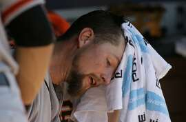 San Francisco Giants starting pitcher Mike Leake sits in the dugout during a baseball game against the Texas Rangers in Arlington, Texas, Sunday, Aug. 2, 2015. (AP Photo/LM Otero)