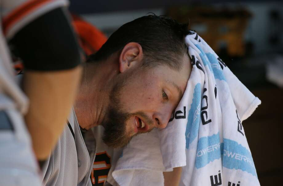 San Francisco Giants starting pitcher Mike Leake sits in the dugout during a baseball game against the Texas Rangers in Arlington, Texas, Sunday, Aug. 2, 2015. (AP Photo/LM Otero) Photo: LM Otero, Associated Press