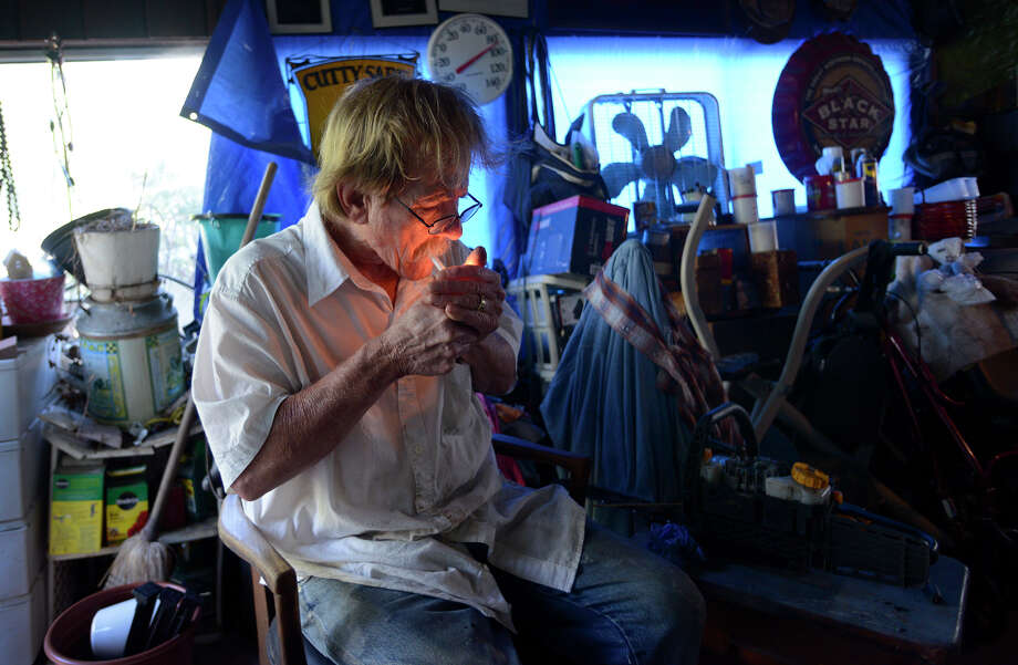 David jeffery lights a cigarette before working on a broken chain saw at his home in Benicia, California, on Thursday, July 30, 2015. Photo: Brandon Chew / Brandon Chew / The Chronicle / ONLINE_YES