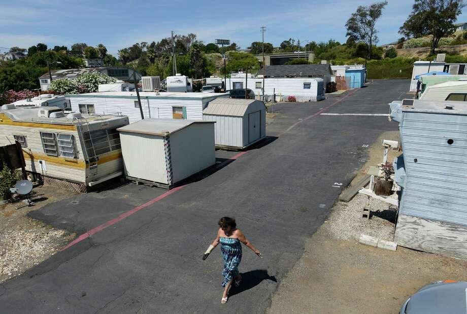 Rachel Pozo walks through the trailer park community in Benicia, California, on Wednesday, July 22, 2015. Photo: Brandon Chew / The Chronicle / ONLINE_YES