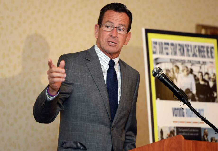Gov. Dannel P. Malloy speaks Thursday during a ceremony at the Bridgeport Holiday Inn to mark the signing of the 1965 Voting Rights Act. Photo: Autumn Driscoll / Hearst Connecticut Media / Connecticut Post