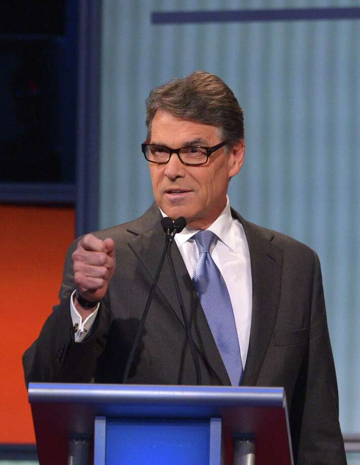 Republican presidential hopeful Rick Perry speaks during the Republican presidential primary debate on August 6, 2015 at the Quicken Loans Arena in Cleveland, Ohio. Seven candidates are debating before the top 10 candidates face off during prime time.  AFP PHOTO/MANDEL NGANMANDEL NGAN/AFP/Getty Images Photo: MANDEL NGAN, Staff / AFP / Getty Images / AFP