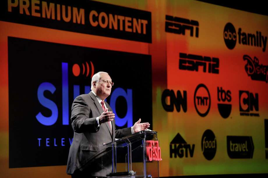 FILE- In this Jan. 5, 2015 file photo, Joe Clayton, president and CEO of Dish Network, introduces the Sling TV, a live television streaming service, at a news conference at the International CES in Las Vegas. Dish said its satellite TV subscriber losses accelerated in the quarter through June, falling 81,000 to 13.9 million, nearly double the loss of 44,000 a year ago. Analysts say that popular channels like ESPN would likely survive any dramatic shift in consumer preference toward online channel packages like Sling TV, which at $20 a month, is far cheaper than traditional pay TV packages. (AP Photo/Jae C. Hong, File) ORG XMIT: NY109 Photo: Jae C. Hong / AP