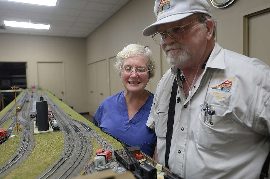 Model train enthusiasts Sheryl and Mickey Taylor were at the model train display opening Thursday. Model trains and landscapes fill the community room at the Hebert Library in Port Neches as members of the East Texas and Gulf Rail Modelers Association set up a display of their work. The free, public display will be up through Saturday. Photo taken Thursday, August 6, 2015 Kim Brent/The Enterprise Photo: Kim Brent / Beaumont Enterprise