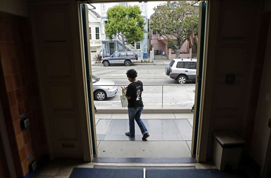"TaNica Lyons of San Francisco makes a lunch delivery for Sprig, a meal delivery service, in San Francisco, Ca. on Thursday, Aug. 6, 2015. ""I have lived here all my life and sometimes I'm like 'oh wow, I have never been here before',"" Lyons says of being a delivery driver for Sprig. ""It helps me get to know the streets more."" Photo: Dorothy Edwards, The Chronicle"