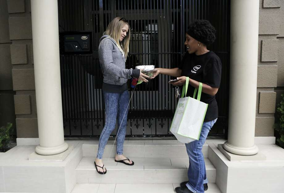 "TaNica Lyons of San Francisco makes a lunch delivery to Collete Davis of San Francisco for Sprig, a meal delivery service, in San Francisco, Ca. on Thursday, Aug. 6, 2015. ""I have lived here all my life and sometimes I'm like 'oh wow, I have never been here before',"" Lyons says of being a delivery driver for Sprig. ""It helps me get to know the streets more."" Photo: Dorothy Edwards, The Chronicle"