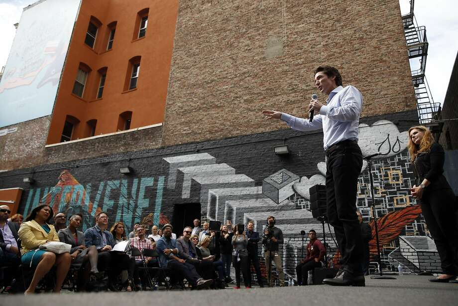 Lakewood Church Pastor Joel Osteen, with his wife, Victoria, preaches during a parking lot church service at City Impact in San Francisco, Calif., on Thursday, Aug. 6, 2015. Photo: Scott Strazzante, The Chronicle