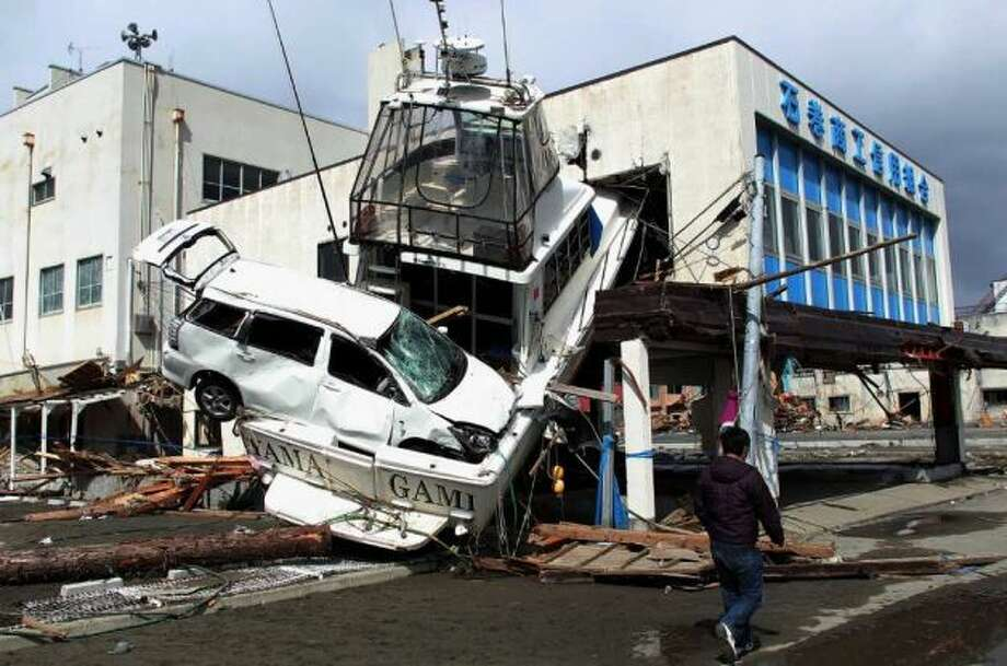 A massive earthquake struck off the coast of Japan on March 11, 2011, spurring a giant tsunami that engulfed large parts of the northeastern part of the country. Here are some photos of affected sites before the tsunami (in some cases), just after and now. Here, a man walks past a car wedged into a boat on March 18, 2011 in Ishinomaki, Japan. Photo: Chris McGrath, Getty Images