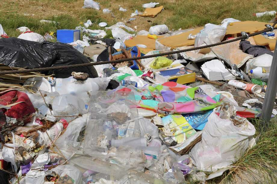 City Council voted to allow Bexar County officials to let a contract for picking up trash in the beleagured Camelot II subdivions, but it is unclear whether the move means actual progress in solving the introlerable trash problem. Photo: /