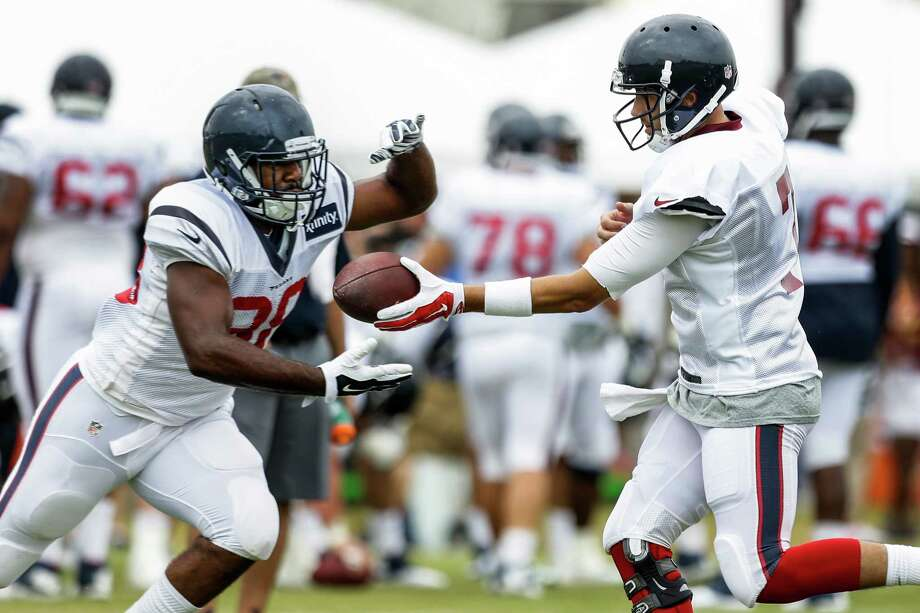 Houston Texans running back Kenny Hilliard (38) takes a handoff from quarterback Brian Hoyer during Texans training camp with the Washington Redskins at the Bon Secours Training Center on Thursday, Aug. 6, 2015, in Richmond, Va. Photo: Brett Coomer /Houston Chronicle / © 2015 Houston Chronicle