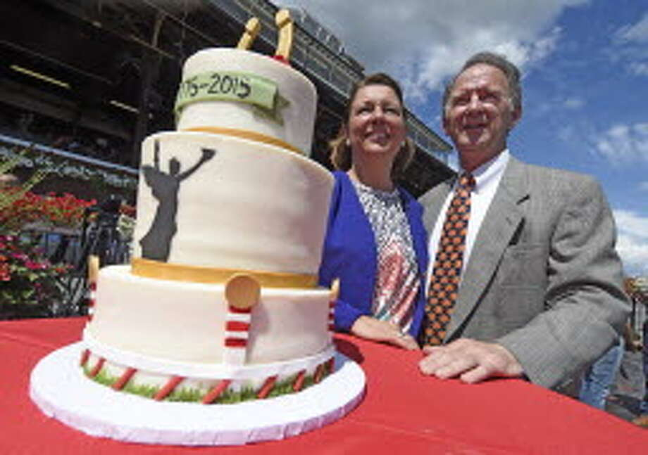 Saratoga Springs Mayor Joanne Yepsen, left joins NYRA CEO Chris Kay in celebrating the 100th anniversary of the City of Saratoga Springs Wednesday afternoon Aug. 5, 2015 at the Saratoga Race Course in Saratoga Springs, N.Y. (Skip Dickstein/Times Union)