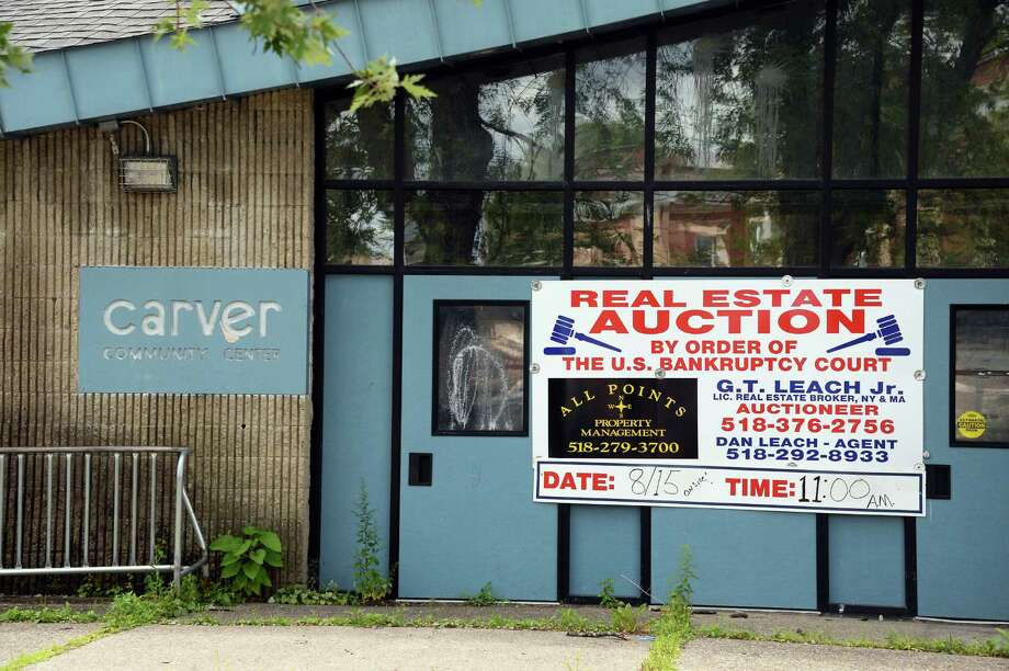 Auction sign at the former Carver Community Center on Craig Street Thursday August 6, 2015 in Schenectady, NY.  (John Carl D'Annibale / Times Union) Photo: John Carl D'Annibale / 00032927A