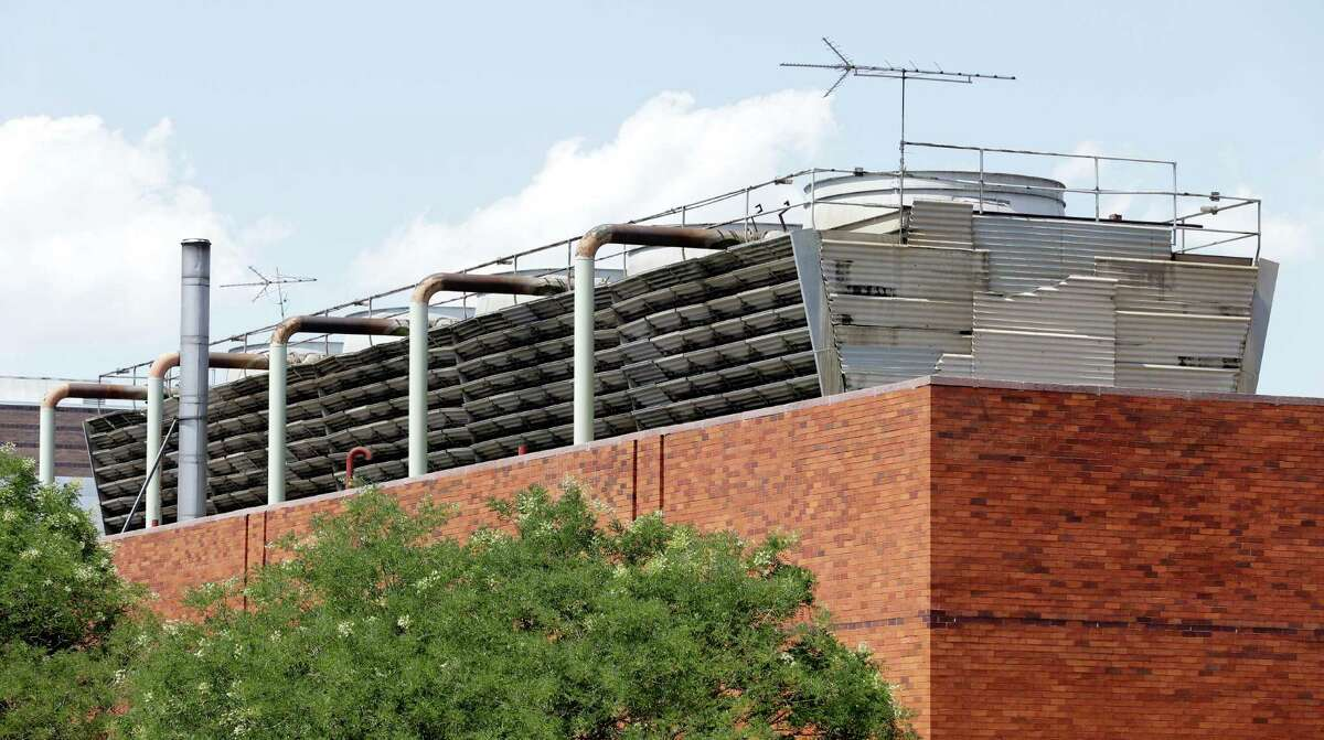 An air conditioning unit sits atop a building at Lincoln Hospital in the Bronx borough of New York, Tuesday, Aug. 4, 2015. Lawmakers are rushing to draft New York's first regulations for a type of heavy-duty rooftop air conditioning equipment amid suspicions that bacteria-laden mist from these units could be the cause of the deadliest known outbreak of Legionnaires' disease in the city's history. (AP Photo/Seth Wenig)