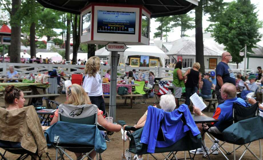 Crowds gather around the picnic area on Thursday, August 6, 2015, at Saratoga Race Course in Saratoga Springs, N.Y. (Phoebe Sheehan/Special to The Times Union) Photo: PS / 00032933A