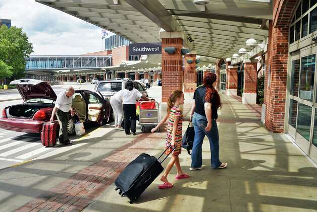Travelers arrive at Albany International Airport Thursday August 6, 2015 in Colonie, NY.  (John Carl D'Annibale / Times Union) Photo: John Carl D'Annibale / 00032934A