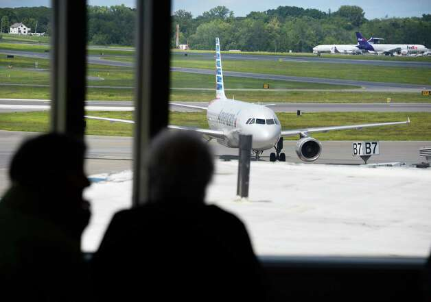 An American Airlines jet as seen from the observation deck at Albany International Airport Thursday August 6, 2015 in Colonie, NY.  (John Carl D'Annibale / Times Union) Photo: John Carl D'Annibale / 00032934A