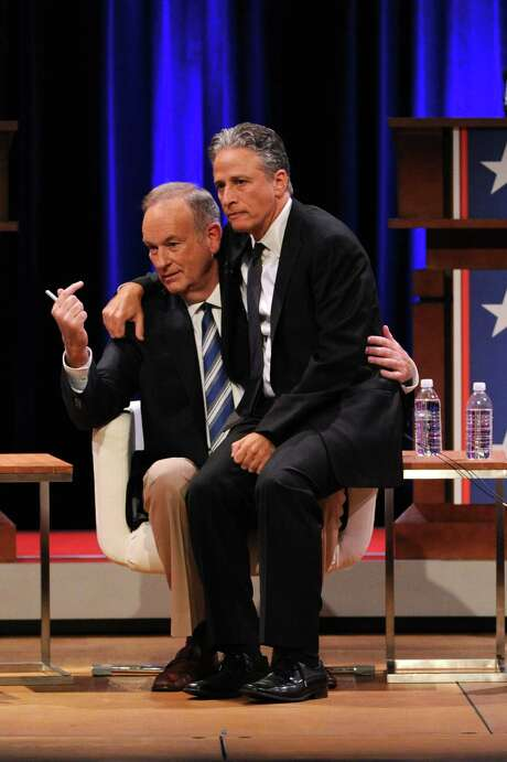 (EXCLUSIVE COVERAGE)  (L-R) Bill O'Reilly and Jon Stewart onstage at O'Reilly Vs. Stewart 2012: The Rumble In The Air-Conditioned Auditorium at Lisner Auditorium at George Washington University on October 6, 2012 in Washington, DC.  (Photo by Jamie McCarthy/Getty Images for The Rumble 2012) Photo: Jamie McCarthy, Staff / Getty Images For The Rumble 2012 / 2012 Getty Images