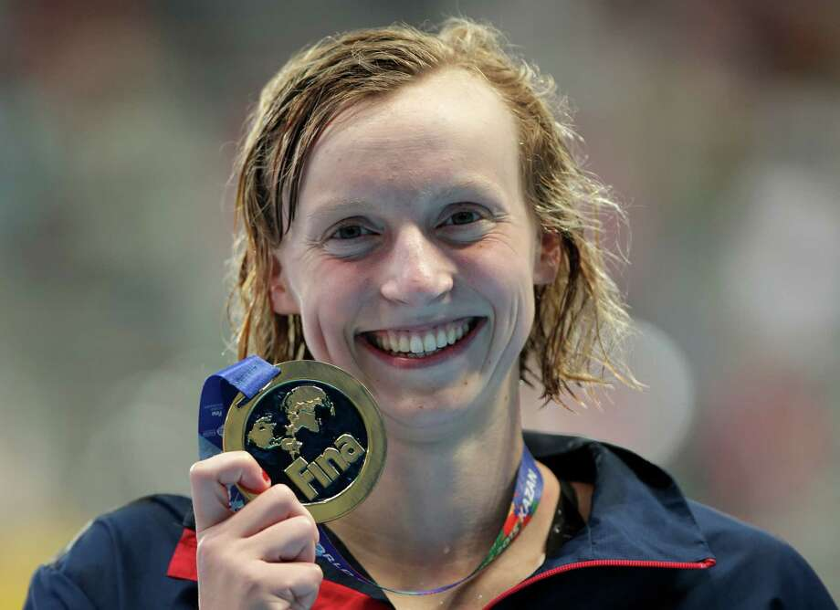 United States' Katie Ledecky holds her gold medal after winning the women's 1500m freestyle final at the Swimming World Championships in Kazan, Russia, Tuesday, Aug. 4, 2015. (AP Photo/Michael Sohn) ORG XMIT: KAZ181 Photo: Michael Sohn / AP