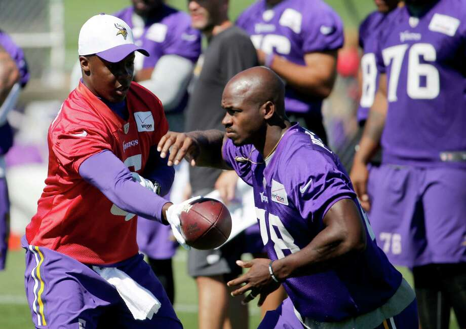 Minnesota Vikings quarterback Teddy Bridgewater hands the ball off to running back Adrian Peterson during practice at an NFL football training camp on the campus of Minnesota State University Wednesday, July 29, 2015, in Mankato, Minn. (AP Photo/Charles Rex Arbogast) Photo: Charles Rex Arbogast, STF / Associated Press / AP