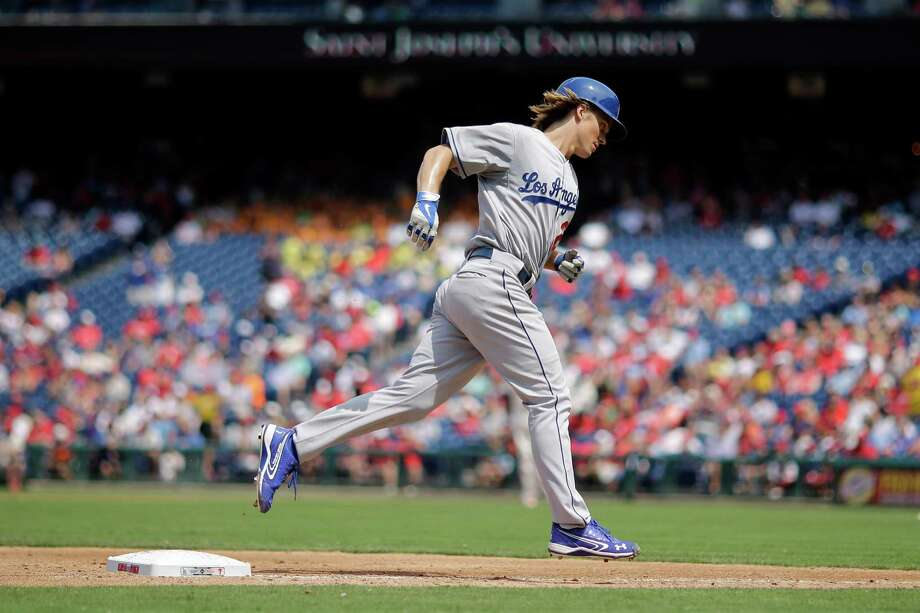 Los Angeles Dodgers' Zack Greinke rounds the bases after hitting a home run off Philadelphia Phillies starting pitcher David Buchanan during the third inning of a baseball game, Thursday, Aug. 6, 2015, in Philadelphia. Los Angeles won 10-8. (AP Photo/Matt Slocum) ORG XMIT: PXS115 Photo: Matt Slocum / AP