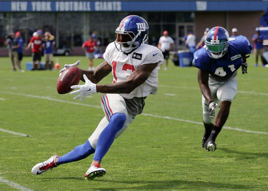 New York Giants wide receiver Odell Beckham Jr. (13) makes a catch as cornerback Dominique Rodgers-Cromartie (41) defends during the team's NFL football training camp, Thursday, Aug. 6, 2015, in East Rutherford, N.J. (AP Photo/Julie Jacobson)  ORG XMIT: NJJJ101 Photo: Julie Jacobson / AP
