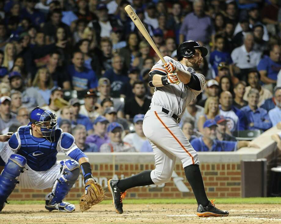 San Francisco Giants' Brandon Belt hits a two-run home run against the Chicago Cubs during the fourth inning of a baseball game, Thursday, Aug. 6, 2015, in Chicago. (AP Photo/David Banks) Photo: David Banks, Associated Press