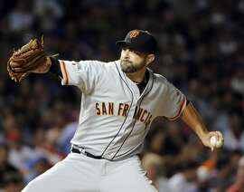 San Francisco Giants relief pitcher Jeremy Affeldt (41) throws against the Chicago Cubs during the fifth inning of a baseball game, Thursday, Aug. 6, 2015, in Chicago. (AP Photo/David Banks)