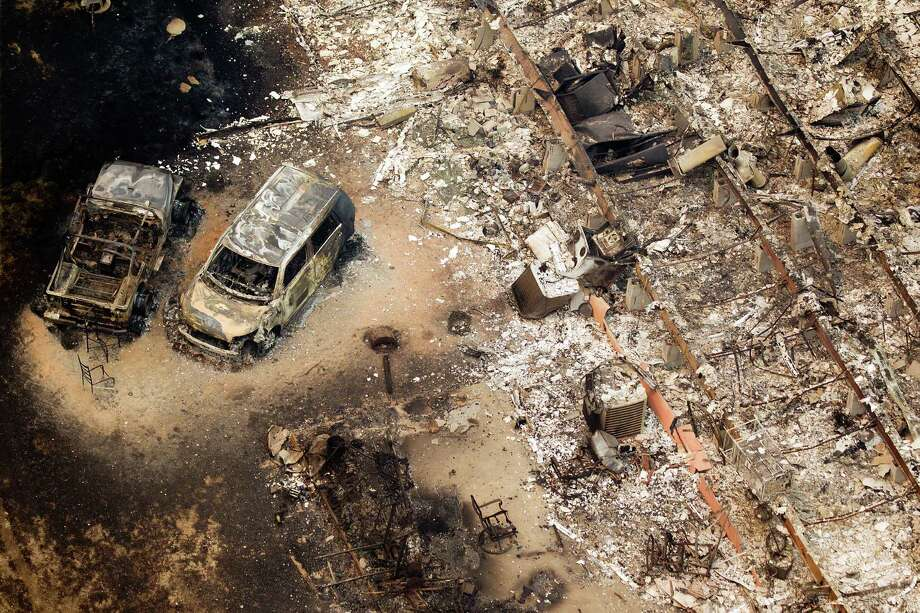 Wildfires near Magnolia left a burned-out house and cars in their wake during the 2011 drought. Photo: Smiley N. Pool, Staff / © 2011  Houston Chronicle