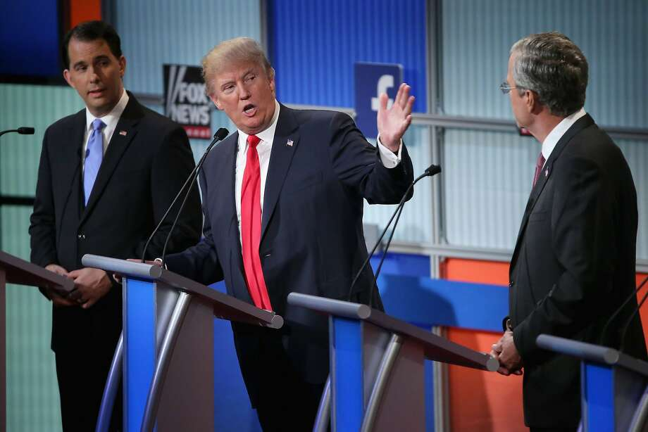 CLEVELAND, OH - AUGUST 06:  Republican presidential candidates (L-R) Wisconsin Gov. Scott Walker, Donald Trump and Jeb Bush participate in the first prime-time presidential debate hosted by FOX News and Facebook at the Quicken Loans Arena August 6, 2015 in Cleveland, Ohio. The top-ten GOP candidates were selected to participate in the debate based on their rank in an average of the five most recent national political polls.  (Photo by Chip Somodevilla/Getty Images) Photo: Chip Somodevilla, Getty Images