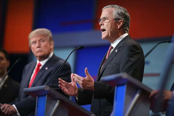 CLEVELAND, OH - AUGUST 06:  Republican presidential candidate Donald Trump listens as Jeb Bush (R) fields a question during the first Republican presidential debate hosted by Fox News and Facebook at the Quicken Loans Arena on August 6, 2015 in Cleveland, Ohio. The top ten GOP candidates were selected to participate in the debate based on their rank in an average of the five most recent political polls.  (Photo by Scott Olson/Getty Images)