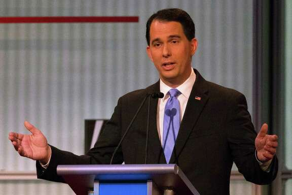 Republican presidential candidate and Wisconsin Gov. Scott Walker speaks during the first Republican presidential debate at the Quicken Loans Arena Thursday, Aug. 6, 2015, in Cleveland. (AP Photo/John Minchillo)