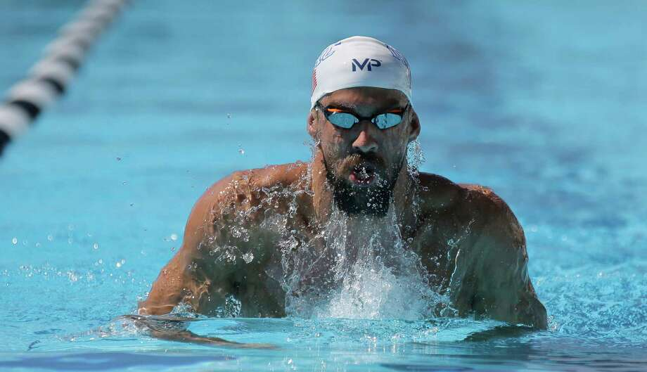 Michael Phelps practices for the U.S. swimming national championships Wednesday, Aug. 5, 2015, in San Antonio, Tex. Phelps, who is scheduled to compete in four events, says he plans to shave his beard before he competes Friday. (AP Photo/Eric Gay) ORG XMIT: TXEG103 Photo: Eric Gay / AP