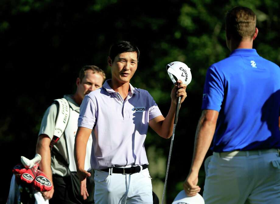 AKRON, OH - AUGUST 06:  Danny Lee of New Zealand shakes hands with Webb Simpson on the 9th green during the first round of the World Golf Championships - Bridgestone Invitational at Firestone Country Club South Course on August 6, 2015 in Akron, Ohio.  (Photo by Sam Greenwood/Getty Images) ORG XMIT: 527945123 Photo: Sam Greenwood / 2015 Getty Images