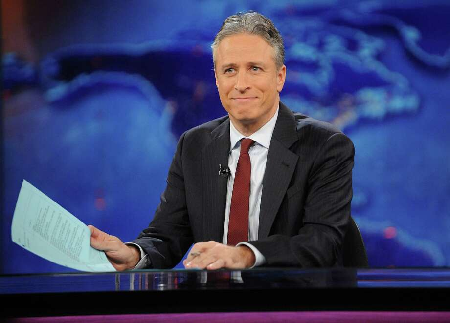 "FILE - This Nov. 30, 2011 file photo shows television host Jon Stewart during a taping of ""The Daily Show with Jon Stewart"" in New York. Stewart says goodbye on Thursday, Aug. 6, 2015, after 16 years on Comedy Central's ""The Daily Show"" that established him as America's foremost satirist of politicians and the media. (AP Photo/Brad Barket, File) ORG XMIT: NYET601 Photo: Brad Barket / FR170635 AP"
