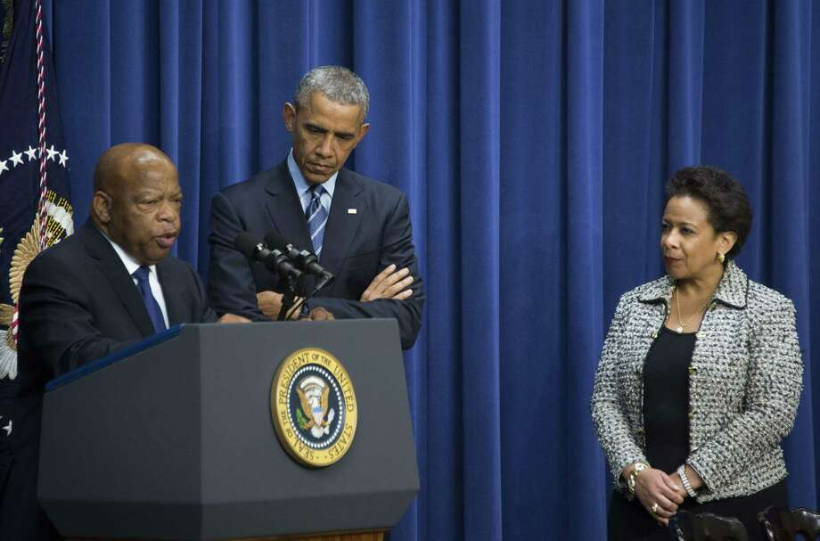 President Barack Obama (center), with U.S. Attorney General Loretta Lynch and Congressman John Lewis, D-Georgia, delivers remarks marking the 50th anniversary of the Voting Rights Act. Photo: Jim Watson /Getty Images / AFP