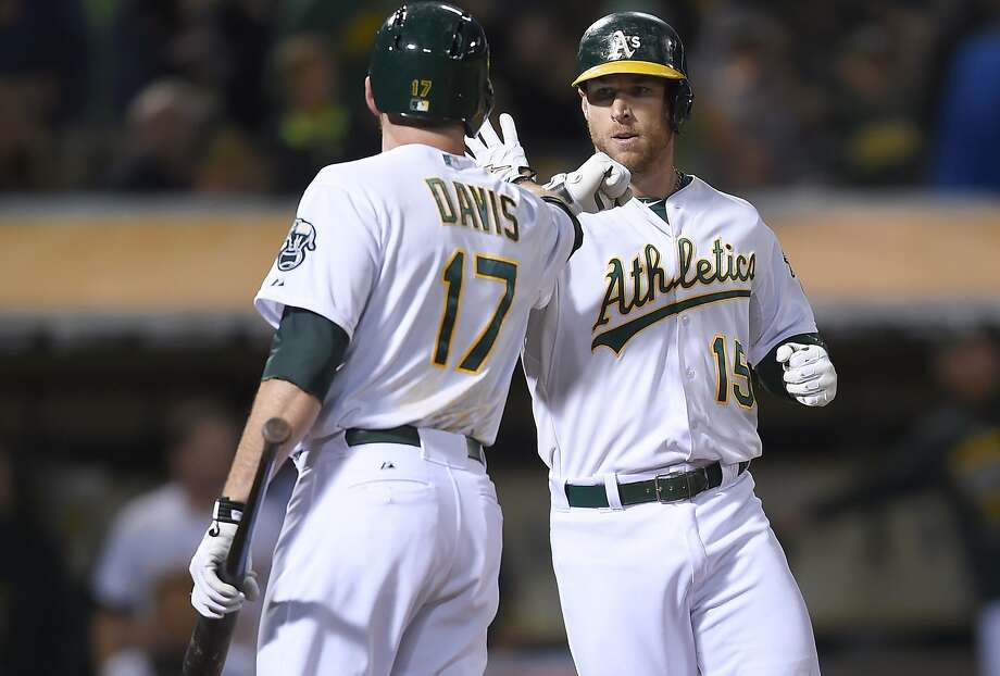 Brett Lawrie  of the Oakland Athletics is congratulated by Ike Davis #17 after Lawrie hit a solo home run against the Houston Astros in the bottom of the fifth inning at O.co Coliseum on August 6, 2015 in Oakland, California.  Photo: Thearon W. Henderson, Getty Images