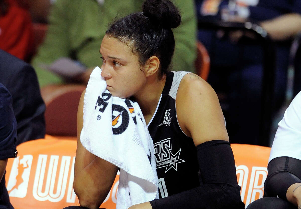 San Antonio Stars's Kayla McBride (21) reacts during her team's 82-51 loss the Connecticut Sun in a WNBA basketball game in Uncasville, Conn., on Tuesday, Aug. 4, 2015.