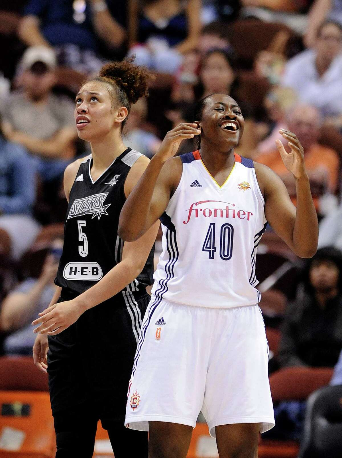 Connecticut Sun's Shekinna Stricklan (40) reacts to a call as San Antonio Stars's Dearica Hamby (5) looks at the scoreboard late in the second half of Connecticut's 82-51 victory in a WNBA basketball game in Uncasville, Conn., on Tuesday, Aug. 4, 2015.