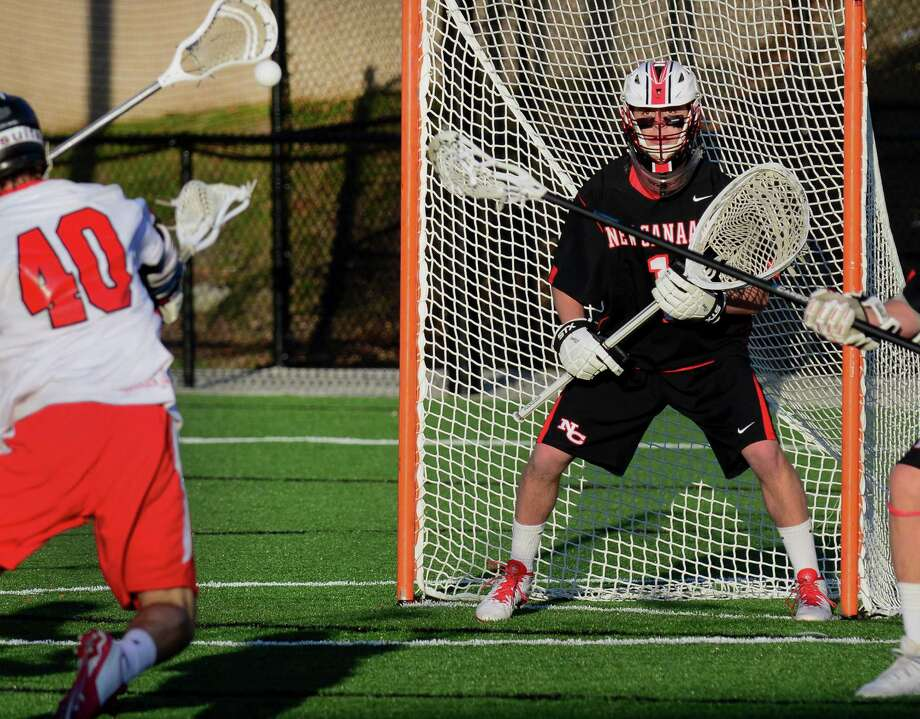 Fairfield Prep's Patrick Lambert, left, attempts a goal shot as New Canaan goalie Drew Morris stands ready to block, during boys lacrosse action at Fairfield University in Fairfield, Conn., on Saturday May 2, 2015. Morris blocked this attempt. Photo: Christian Abraham / Hearst CT Media / Connecticut Post