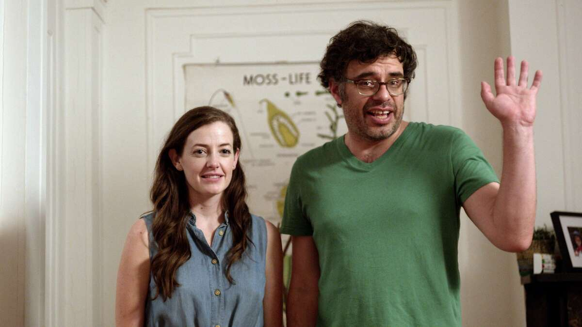 CAPTION: Charlie (Stephanie Allynne) and Will (Jemaine Clement) attempt to sort out their new post-marital order in
