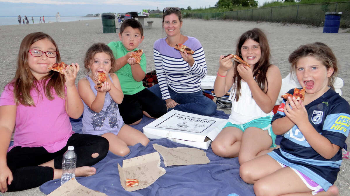 Alexa Crowell, 8, visiting from California; Emma Bashawaty, 4, of Middlebury; Alexa's brother, Burke, 5, and Emma's mom Liz and sisters Maya, 9, and Kayla, 7, at the last Sand Jam party of the season at Jennings Beach.