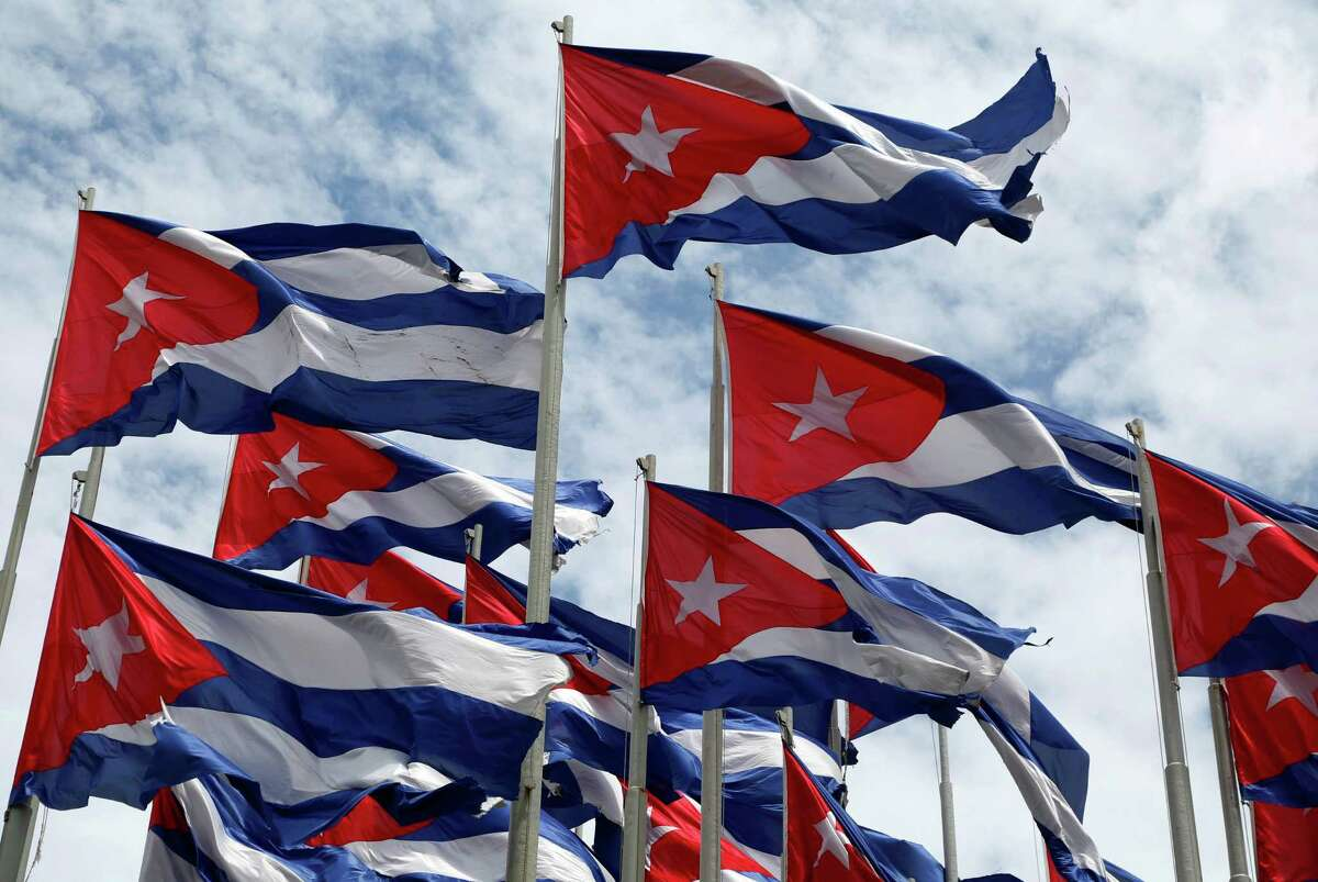 Cuban flags fly beside the U.S. Embassy in Havana this summer.