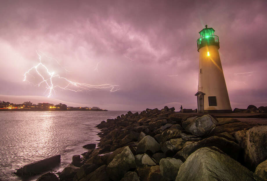 "Edwin Bull, who photographed the lightning storm near the Walton Lighthouse in Santa Cruz, recounted: ""After dinner and a wonderful night of painting at our local paint night here in Santa Cruz, I heard a distinctive sound I haven't heard in years...... Thunder!!! Not being much of a painter, I rushed home to gather my photography gear and headed out. Because it only thunders here once a year or less I wasn't expecting much but after missing the last lightning storm there was no chance I was going to miss this one!!!"" Photo: Courtesy Edwin Bull"