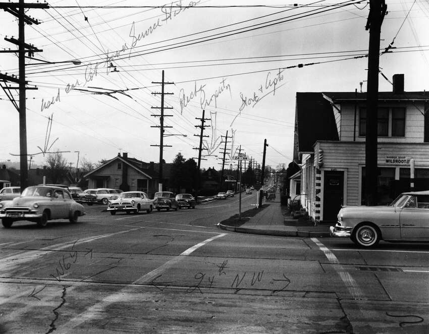 This June 1960 photo shows the corner of 24th Avenue Northwest and Northwest 65th Street in Ballard. At one time, tiles marking the original Ballard street names -- before annexation in 1907 -- would have marked the corners here, with the names would have been Third Avenue (for 24th) and either Ship Street or Woodland Park Avenue (the names weren't necessarily the same the length of a given street), according to an 1890 map of the Seattle area in the David Rumsey Historical Map Collection.