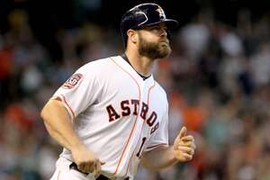Recent hernia surgery to limit Astros' Evan Gattis this spring - Photo
