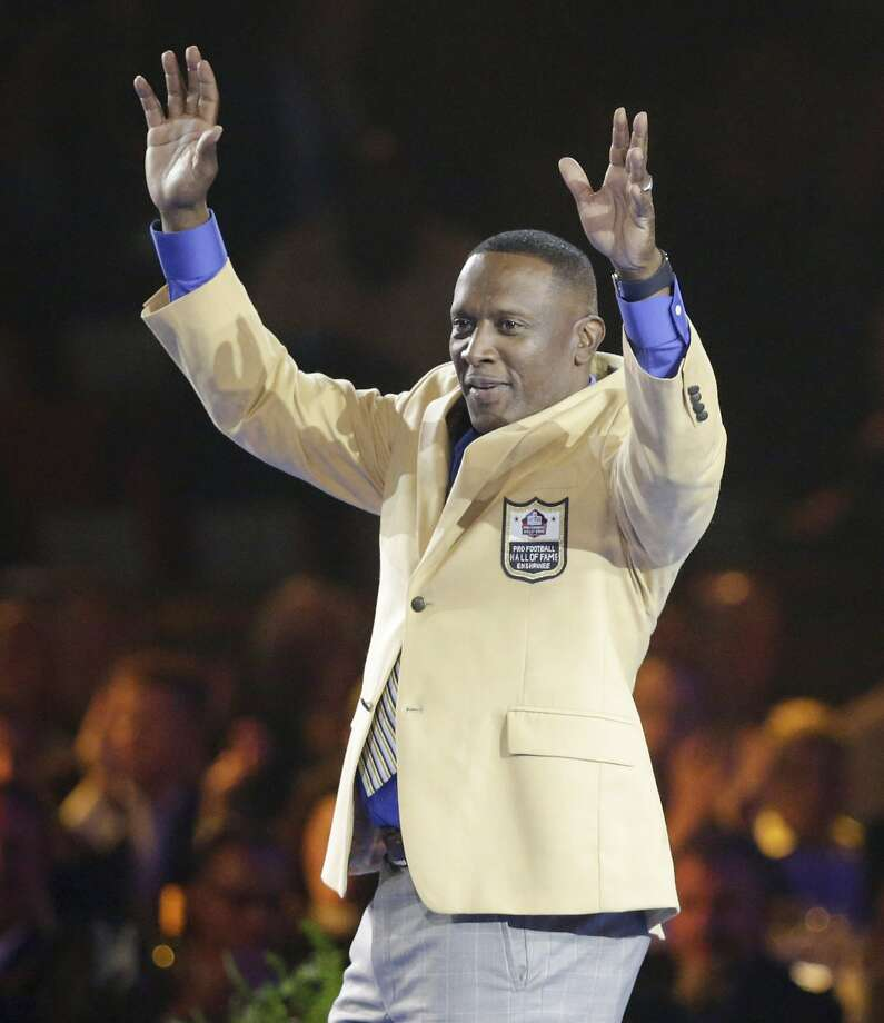 Tim Brown acknowledges the crowd after getting his Hall of Fame jacket at a dinner this week. Photo: Scott Heckel, Associated Press